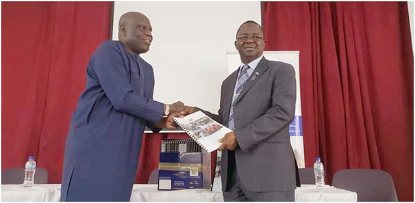 WA BiCC's Senior Policy Specialist, Adewale Adeleke, handing over the printed copies of the CCAP.